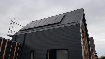 14 panelen AXITEC 300 WP te Herk-De-Stad