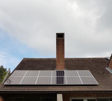 18 panelen AXITEC 300 WP met Solar Edge te Hasselt