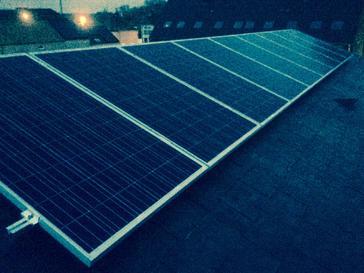 9 panelen AXITEC te Lebbeke op leien dak